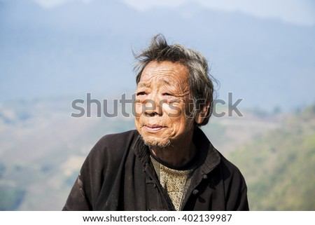 Hagiang, Vietnam - Feb 13, 2016: Portrait H'mong ethnic old man in Ha Giang, Vietnam. The Hmong are an Asian ethnic group from the mountainous regions of China, Vietnam, Laos, and Thailand - stock photo