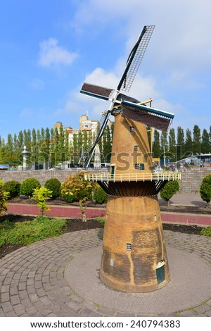 HAGUE - SEPTEMBER 19: Scaled replica of a windmill at Madurodam minature park, taken on September 19, 2014 in Hague, Netherlands - stock photo