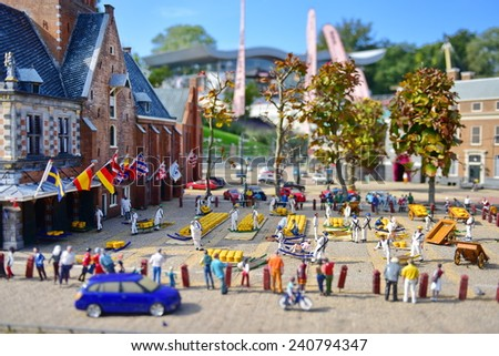 HAGUE - SEPTEMBER 19: Scaled replica of Alkmaar Cheese Market at Madurodam minature park, taken on September 19, 2014 in Hague, Netherlands - stock photo