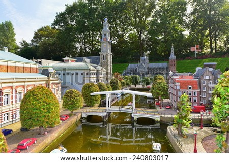 HAGUE - SEPTEMBER 19: Scaled replica of traditional Dutch canal houses at Madurodam minature park, taken on September 19, 2014 in Hague, Netherlands - stock photo