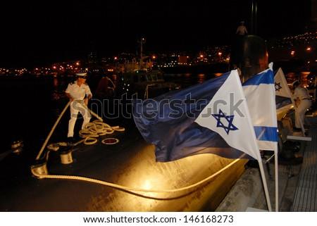 HAIFA, ISR - DEC 16 2007: Israeli submarine in Haifa port on Dec16 2007. The Israeli submarine flotilla is elite and voluntary serving as the attacking underwater force of the Israel Navy. - stock photo