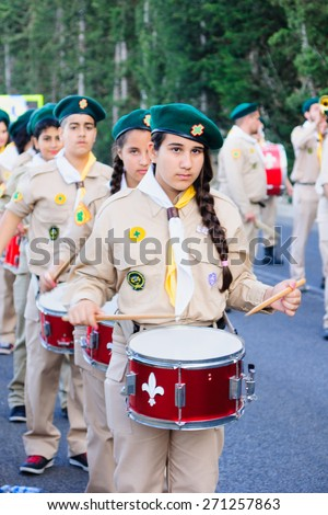 HAIFA, ISRAEL - APR 19, 2015: A group of Christian scouts takes part in the annual our lady of Mount Carmel parade, in Haifa, Israel. This annual event commemorates the hiding of Mary statue in WWI - stock photo