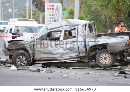 HAIFA, ISRAEL, APRIL 10. Crashed car (pickup trucks) in a fatal car crash accident. Ambulances can be seen behind. April 10, 2013 in Haifa, Israel  - stock photo