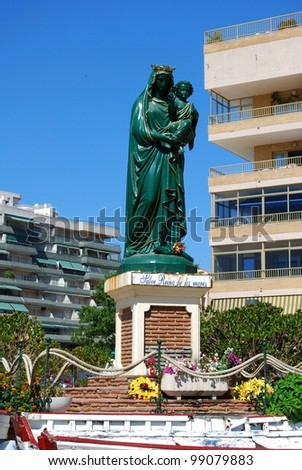 Hail Queen of the seas statuette (Salve Reina de los mares) along the seafront, Fuengirola, Costa del Sol, Malaga Province, Andalusia, Spain, Western Europe. - stock photo