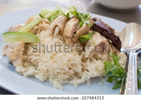 hainanese rice. One of most favorite Chinese food in asia. Boil rice with chicken soup and serve with steam chicken meat. easy street food. Chicken with rice  - stock photo
