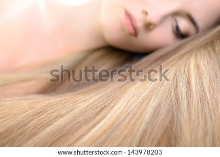 Hair. Beautiful bond girl with healthy long hair. Haircare and hairstyle. - stock photo