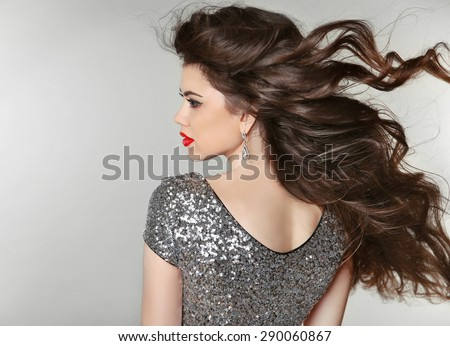 Hair. Beautiful Brunette Girl. Healthy Long Hair. Beauty Model Woman. Blowing Hairstyle. - stock photo