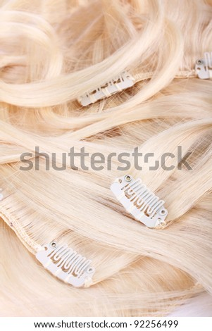 Hair blond extensions set, close up - stock photo