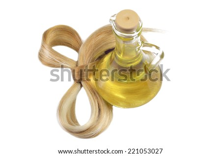 Hair bow and oil bottle - stock photo