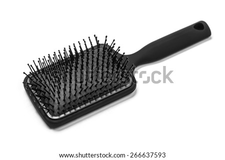 Hair brush with a black handle isolated on white - stock photo