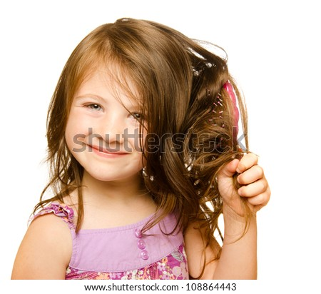 Hair care concept with portrait of girl brushing her unruly, tangled long hair isolated on white - stock photo