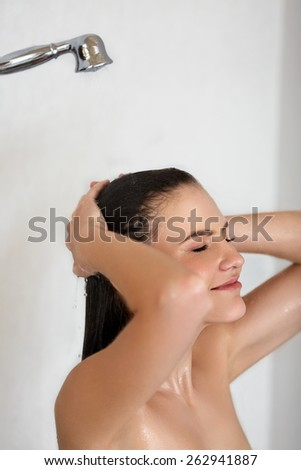 Hair care. Woman in shower washing hair.  - stock photo