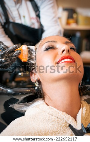 Hair coloring in the salon - stock photo