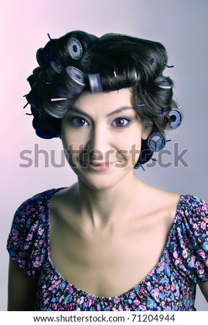 Hair-curlers. Beautiful woman with hair curlers on the head. - stock photo