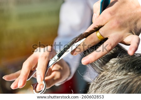 Hair cut at a hairdresser salon. - stock photo