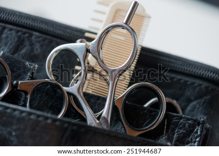 Hair cutting tools: Scissors and comb - stock photo