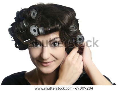 Hair-rollers. Beautiful woman with hair rollers on the head. Hairdo with hair-rollers. - stock photo