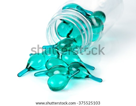 Hair serum capsule isolated on the white background. - stock photo