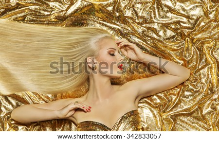 Hair Style Model, Fashion Long Straight Hairstyle, Woman Lying on Gold Color Cloth - stock photo