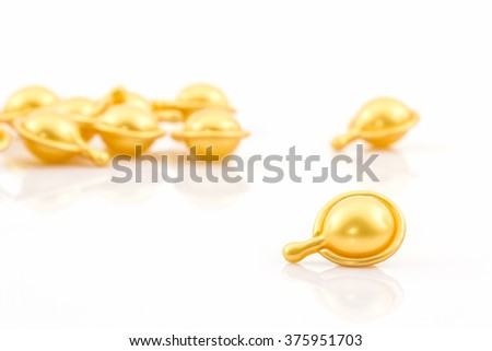 Hair vitamin serum capsule gold color on white background.  - stock photo