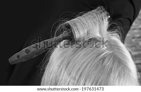 Hairbrush in hair - stock photo