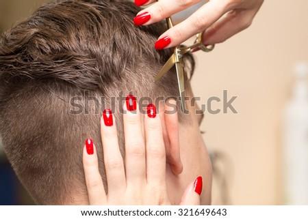 Haircut ear in a beauty salon - stock photo