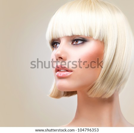 Haircut. Hairstyle. Beautiful Model with short Blond hair - stock photo