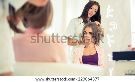 Hairdresser doing haircut for women in hairdressing salon. Concept of fashion and beauty. Positive emotion. - stock photo