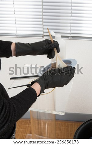 Hairdresser preparing a color to dye the hair  - stock photo