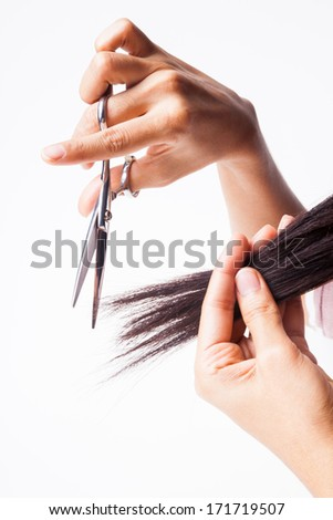 Hairdresser's Hands with Scissors cut Hair isolated - stock photo