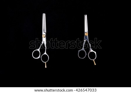 hairdresser scissors isolated on black background - copy space  - stock photo