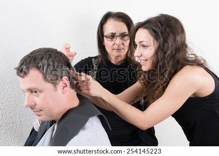 Hairdressing and trainees learning the barber profession - stock photo