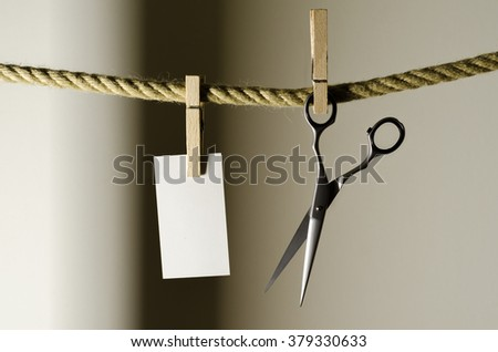Hairdressing scissors over the rope with clip - stock photo