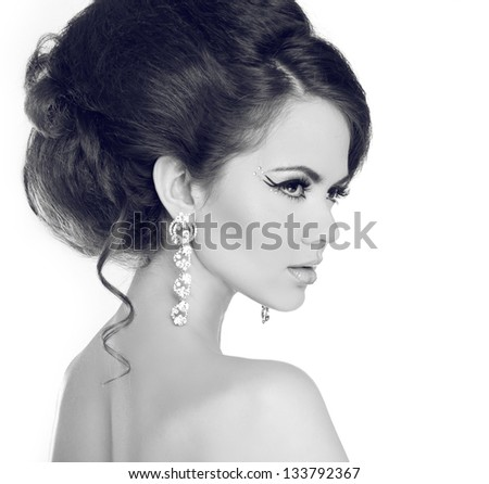 Hairstyle. Elegant brunette woman with jewelry isolated on white background. Black and white photo - stock photo