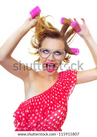 Hairstyle Pin-Up Girl holding curlers, isolated on white - stock photo