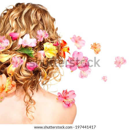 Hairstyle with colorful flowers. Beautiful healthy curly hair decorated with flowers. Isolated on white background. Hair care concept. Backside view - stock photo