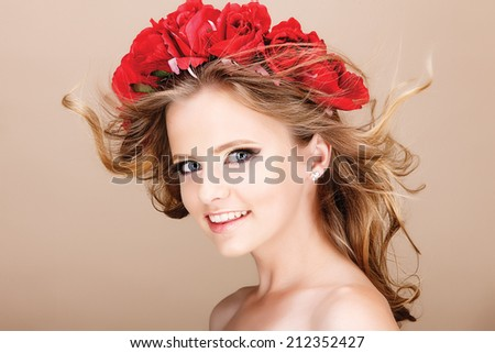 Hairstyle with flowers. Fantasy girl portrait in pastel colors. Summer fairy portrait. Long permed hair. - stock photo