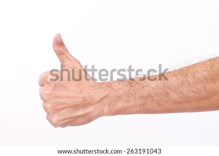 hairy man's hand giving thumb up gesture - stock photo