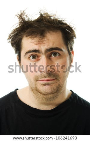 Hairy tired man on white background. - stock photo
