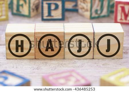 Hajj word written on wood cube - stock photo