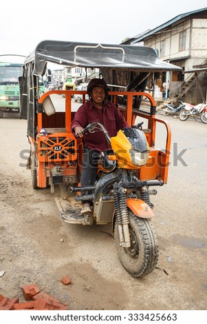 HAKHA, MYANMAR - JUNE 19 2015: Local tuk tuk transportation in the Hakha region in Chin State, Myanmar. - stock photo
