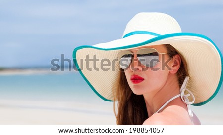 hal face portrait of young beautiful woman with red lips in straw hat - stock photo