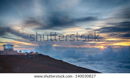 Haleakala Observatory on the summit of the volcano on Maui during sunset. - stock photo