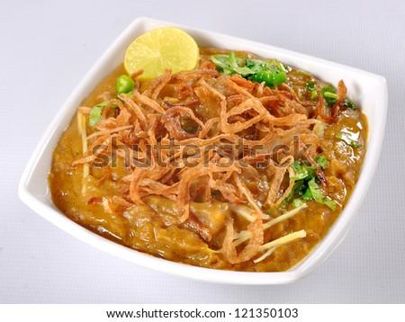 Haleem in White Dish Top - stock photo