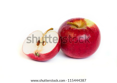 half an apple and whole red apple - stock photo