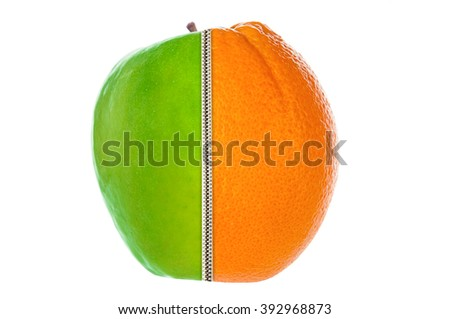 Half apple and orange joined by zipper - stock photo