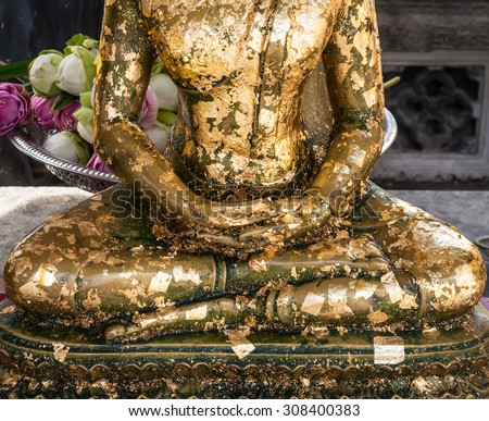 Half Buddha statues in meditation pose . - stock photo