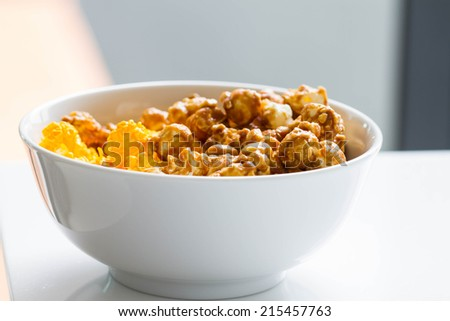 half cheese and half caramel popcorn in white bowl - stock photo