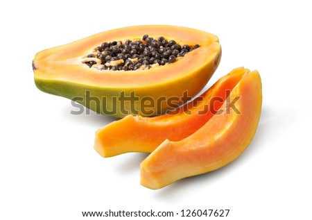 Half cut papaya fruits on white background - stock photo
