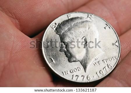 Half dollar coin on arm - stock photo
